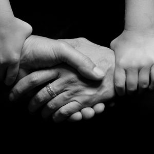 Four individual's hands unified.