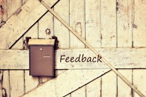 "image of mailbox on barn door titled ""feedback"""