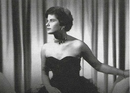 Vintage photograph of woman in black dress sitting down.