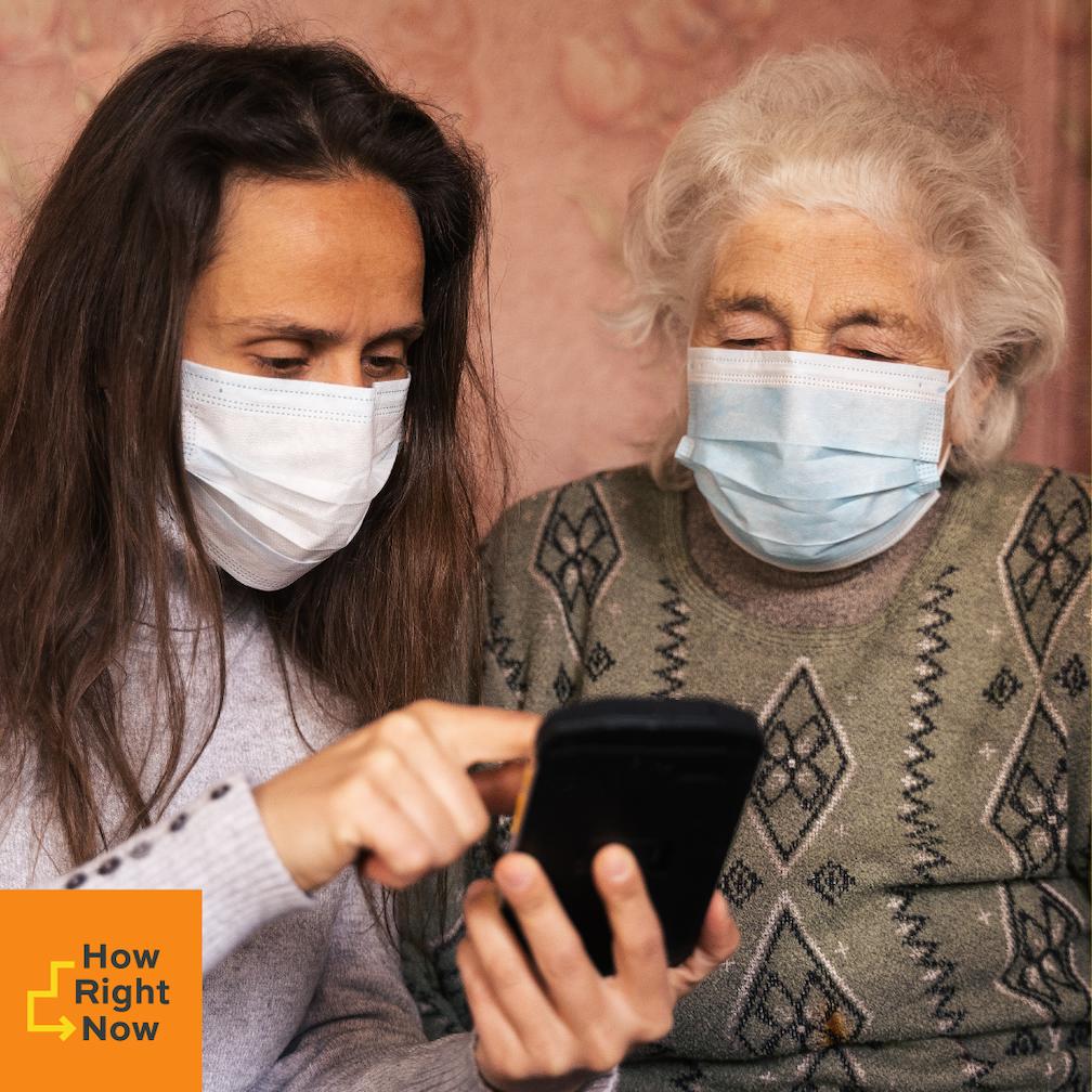 A women Caregiver and an elderly Women wearing facemasks